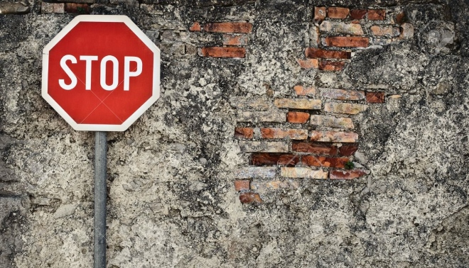 4658808-stop-sign-against-grungy-wall-may-represent-protection-dead-end-wrong-way-resistance